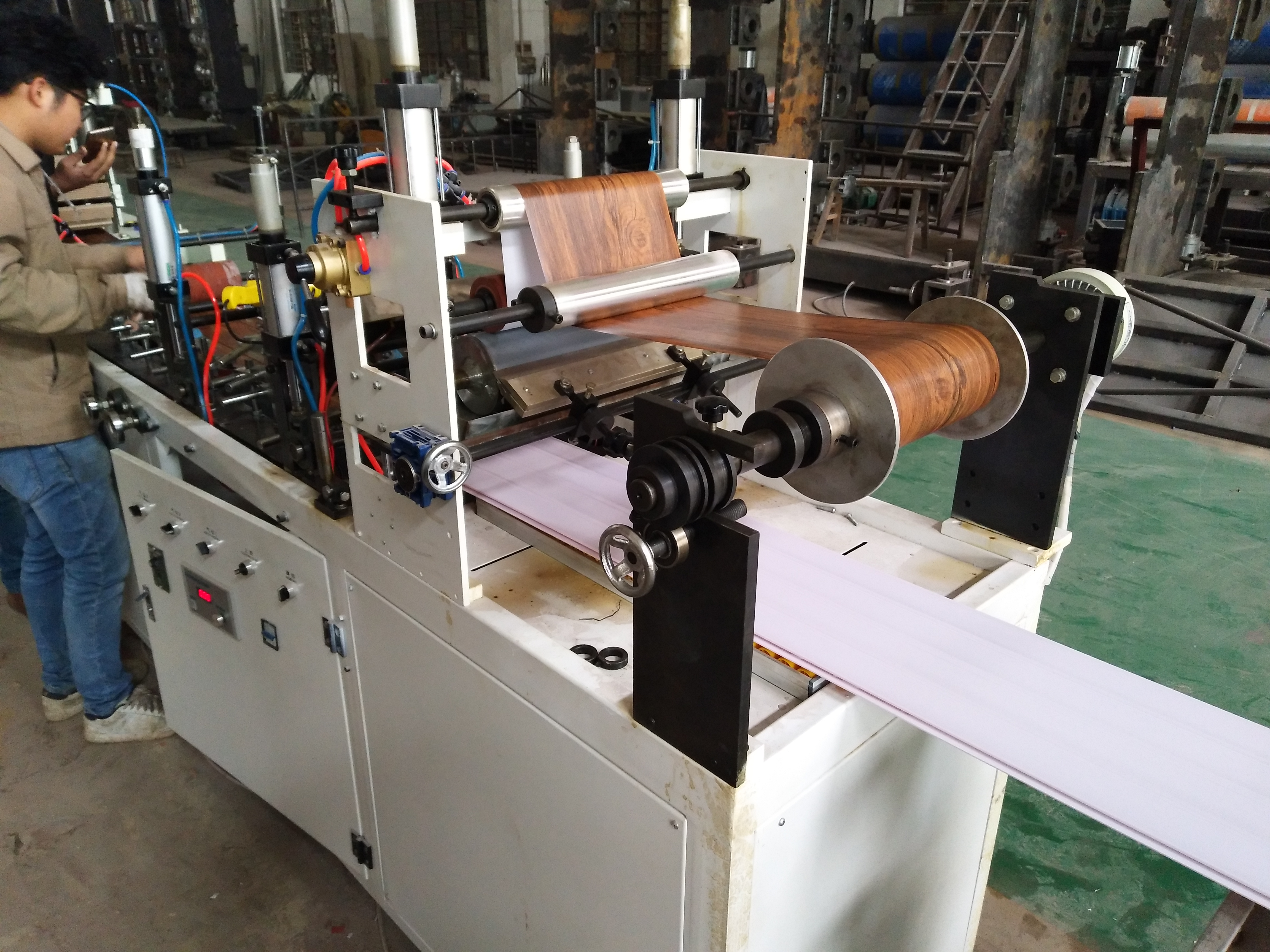 We test PVC wall panel extrusion line before shipping to Pakistan